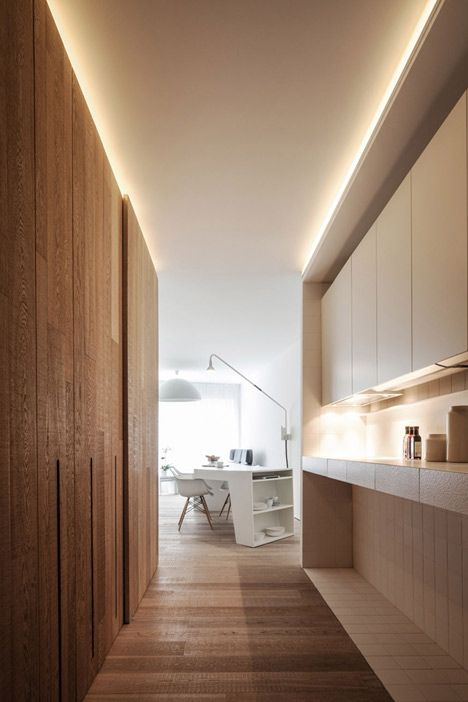 *Cove lighting above full height cupboard doors. Loft MM by C.T. Architects