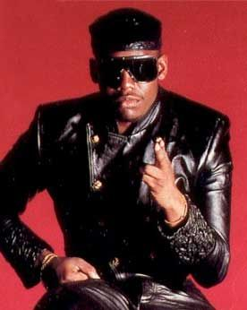 """Kool Moe Dee (born Mohandas Dewese), hip-hop MC and member of the old school hip-hop group the Treacherous Three. He performed his freestyle onstage roast of old school party rapper Busy Bee Starski, a performance frequently cited as a pivotal moment in the development of the """"battle rap"""" and the lyrical rapper.  He was one of the 1st rappers to earn a Grammy Award and was the 1st rapper to perform at the Grammys. He is also known for his long-running rivalry with LL Cool J."""