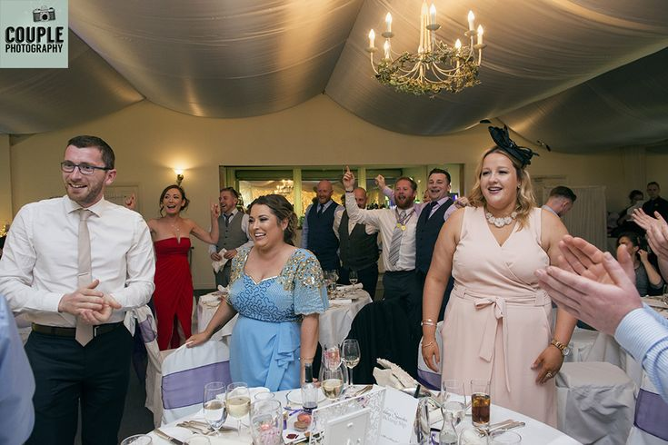 The guests cheer on the newlyweds. Weddings at Rathsallagh House Hotel by Couple Photography.