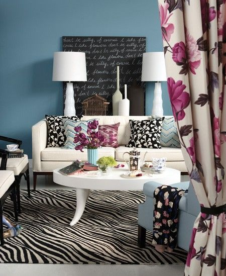 Bright and cheerful prints inject an instant dose of playful style to a space. Black and white furniture, a zebra-print rug and chalky azure walls let the peonies bloom in this design.