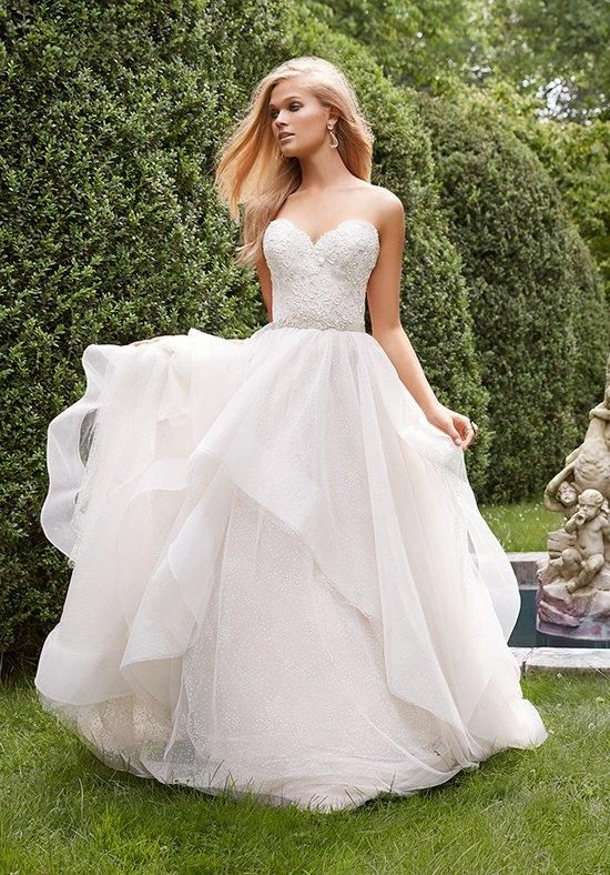 Ivory / cashmere dotted tulle bridal ball gown with horsehair edged cascades throughout skirt | Alvina Valenta | https://www.theknot.com/fashion/9551-alvina-valenta-wedding-dress