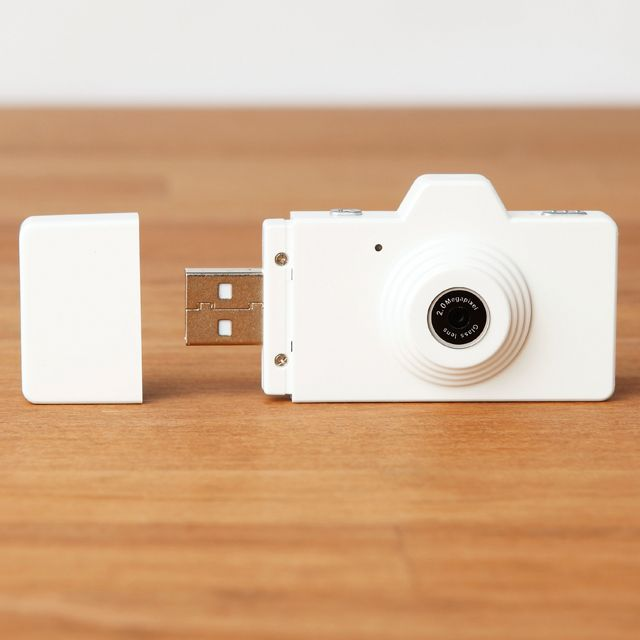 Awesome!  Tiny camera that plugs directly into your USB port. Takes photos and video!