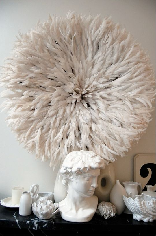 Juju hat. all in white. feather decoration. african inspo. total white