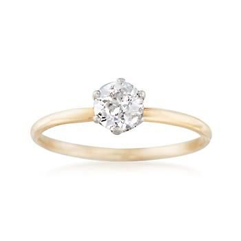 C. 1910. Our Estate collection presents this remarkable Tiffany & Co. antique from the Edwardian era. The solitaire engagement ring showcases a .66 carat certified round brilliant-cut diamond in six platinum prongs. The traditional band is 14kt yellow gold. GIA Cert#6173560967. Certified diamond Tiffany Jewelry engagement ring. <b>Exclusive, one-of-a-kind Estate Jewelry.</b> Free shipping & easy 30-day returns. Fabulous jewelry. Great prices. Since 1952.