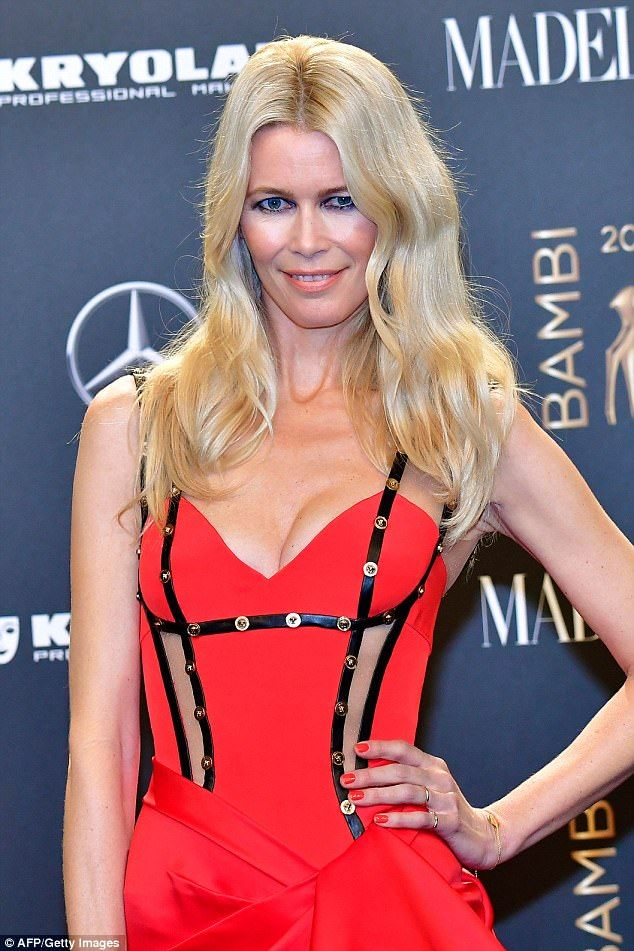 The 47-year-old looked stunning in a black satin sweatshirt and cropped joggers as she attended a signing for her new book on Thursday, self-titled Claudia Schiffer, in her home country Germany.