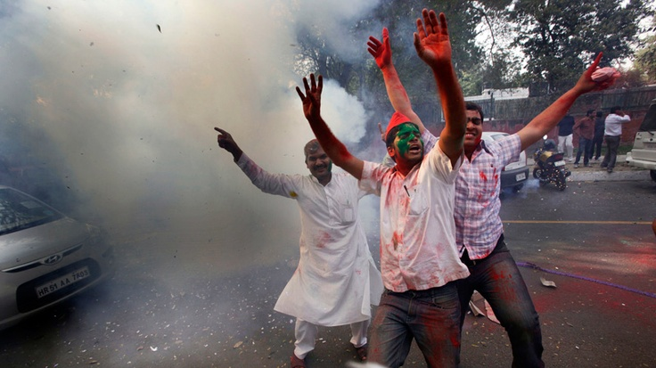 Samajwadi Party supporters, faces smeared with colored powder, celebrate by burning firecrackers at their party office in New Delhi, India, Tuesday, March 6, 2012. (AP / Manish Swarup)    http://www.ctv.ca/CTVNews/World/20120306/india-election-result-samajwadi-party-ousting-bahujan-samaj-in-uttar-pradesh-120306/#ixzz1oLpI3XdW