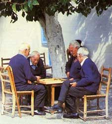 Omodos locals (Cyprus) playing tavli (backgammon) at the village square Play backgammon > on.fb.me/1869cF3
