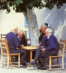 Omodos locals (Cyprus) playing tavli (backgammon) at the village square Play backgammon > on.fb.me/1869cF3