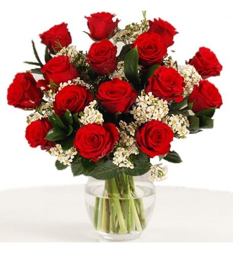 If you love classic red rose bouquets but want a modern twist then this is the perfect bouquet to send to your loved one. Our florists have used tiny white waxflowers to contrast with the velvety petals of the fifteen red roses and have completed the hand-tied bouquet with classic ruscus foliage.