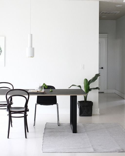 70/70 table and Visu sled base chair by Muuto, Aalto A110 pendant by Artek. Via A Merry Mishap.