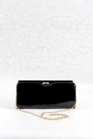 Τσάντα φάκελος μαύρο, υφή λουστρίνι.  Κλασικό σχέδιο με όμορφο κούμπωμα.  Εσωτερικά μαύρη φόδρα, 1 μεγάλος ενιαίος χώρος και  1 επιπλέον μικρότερη  θήκη με φερμουάρ.