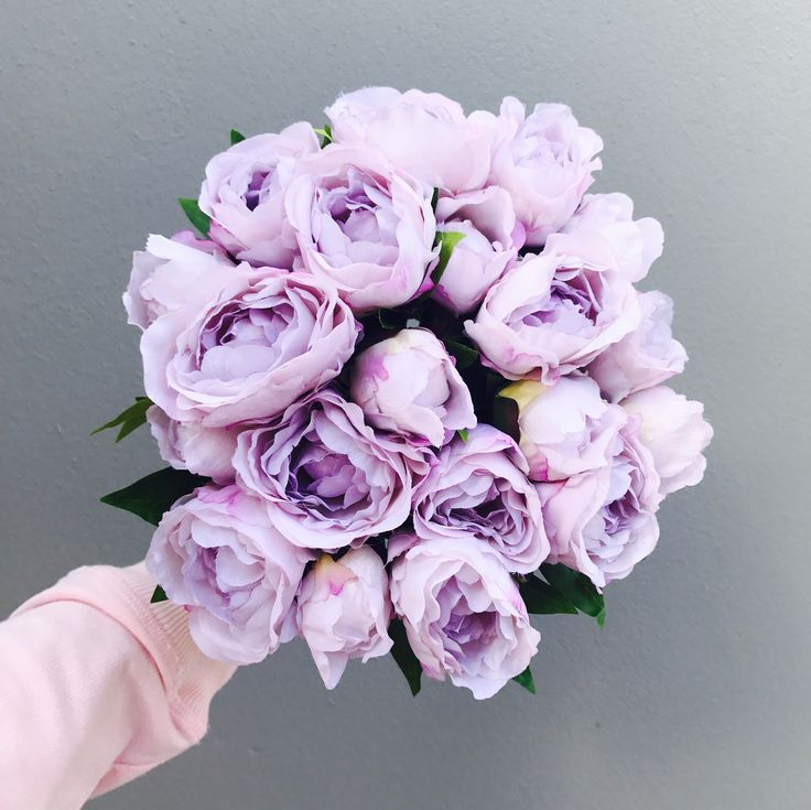 Premium artificial lilac silk peonies. This stunning shade of purple is the 2017 new release, with  a hard centre so the flowers wont collapse. These will keep their shape forever! 5 stems per bouquet including three open blooms and two buds with foliage . Approximately 24cm in height. *Image shows four bouquets.