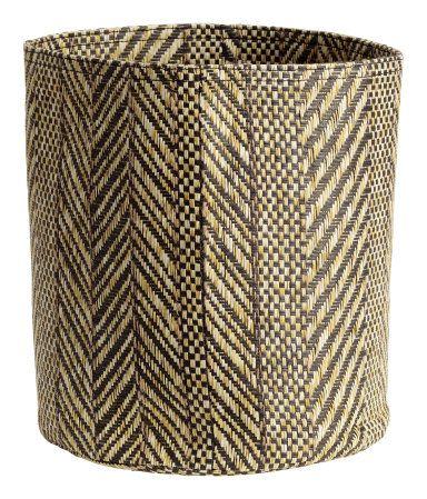 Cylindrical storage basket in braided paper straw. Diameter 8 1/4 in., height 9 1/2 in.