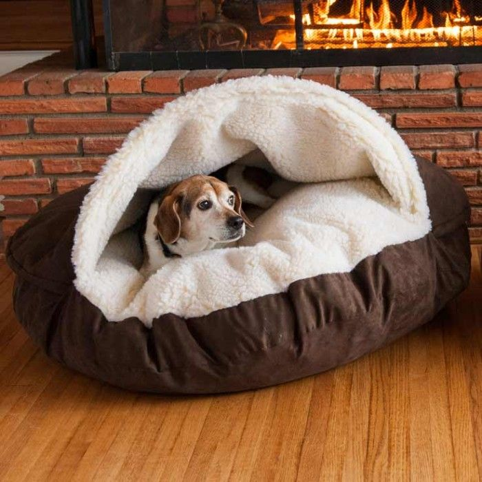 This luxury nesting dog bed features a Microsuede exterior and is great for dogs or pets who enjoy staying under the covers. Some dog breeds, such as dachshunds and terriers, prefer the extra feeling of security by wrapping themselves up in bed