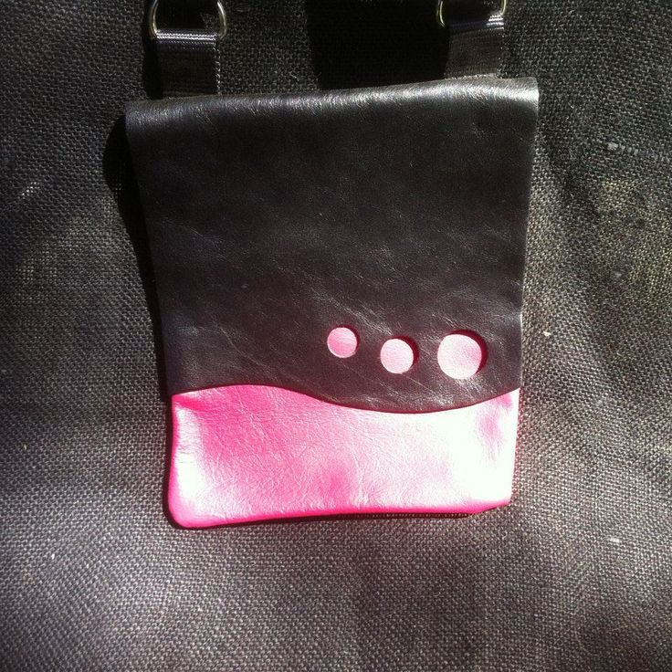 Leather Sling Bag, black and pink  front and red back adjustable strap, small pocket inside for phone or keys. Meausures 18cm Wide and 24cm Height.