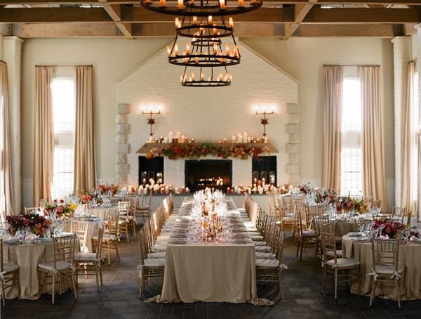 i absolutely love this decor setup. the use of the long, communal table punctuated with traditional rounds, gives this event an edgy traditional feel.