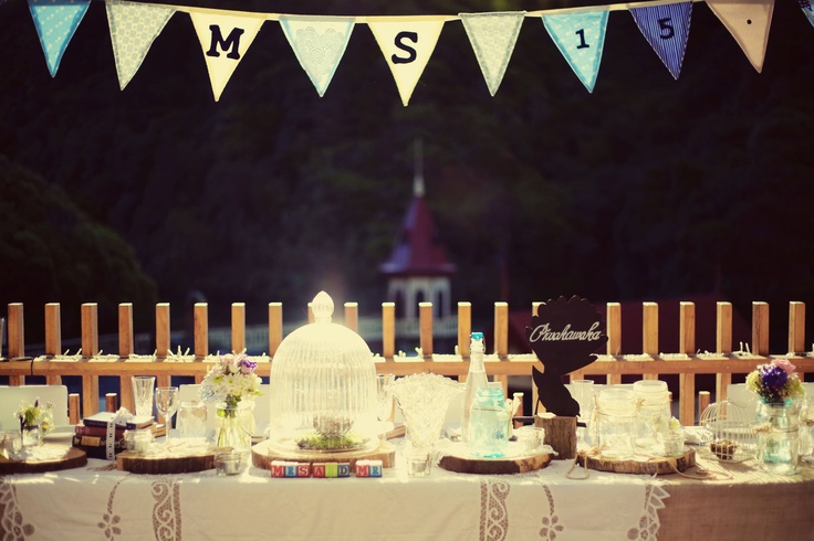 A Vintage & Pretty love bird and rustic themed head table. This photo was taken at by Melissa Thorburn photography at Zealandia.