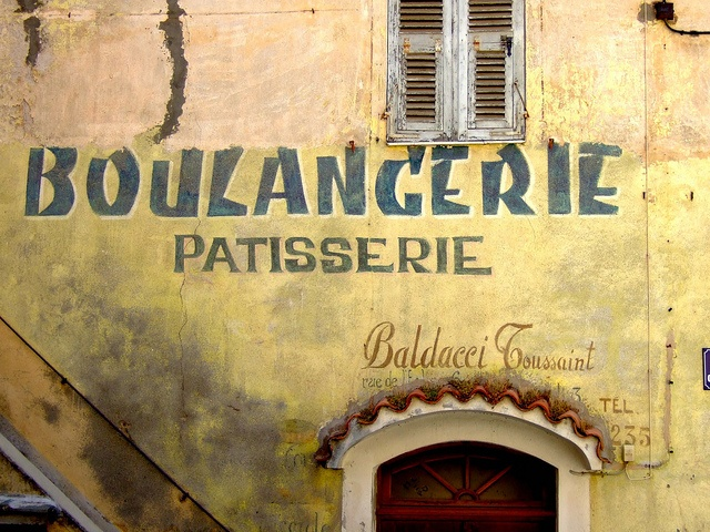 This is where people buy their daily bread and croissants... this is the walls of and authentic boulangerie in a village of Corsica... looks like a painting doesn't it?