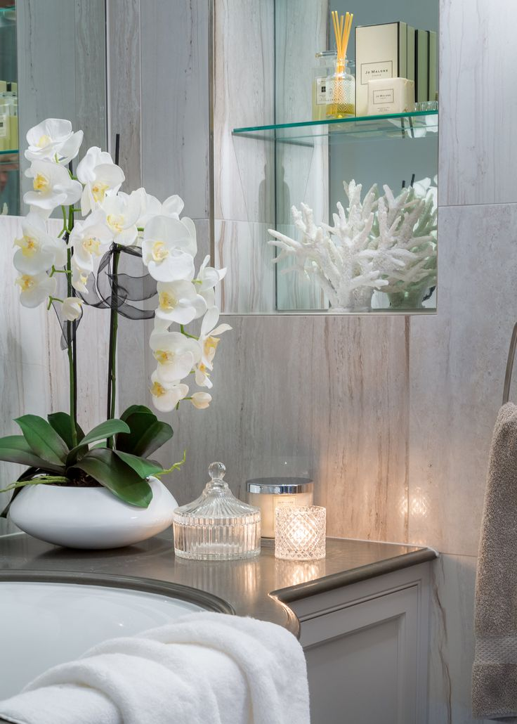 Offering a spa-like feel, this feminine bathroom in our latest project is dressed with Jo Malone candles and diffuser; a sanctuary of relaxation and indulgence. #interiordesign #luxurylife #luxury #london #luxuryproperty #luxuryhomes #londonproperty #luxuryinteriors