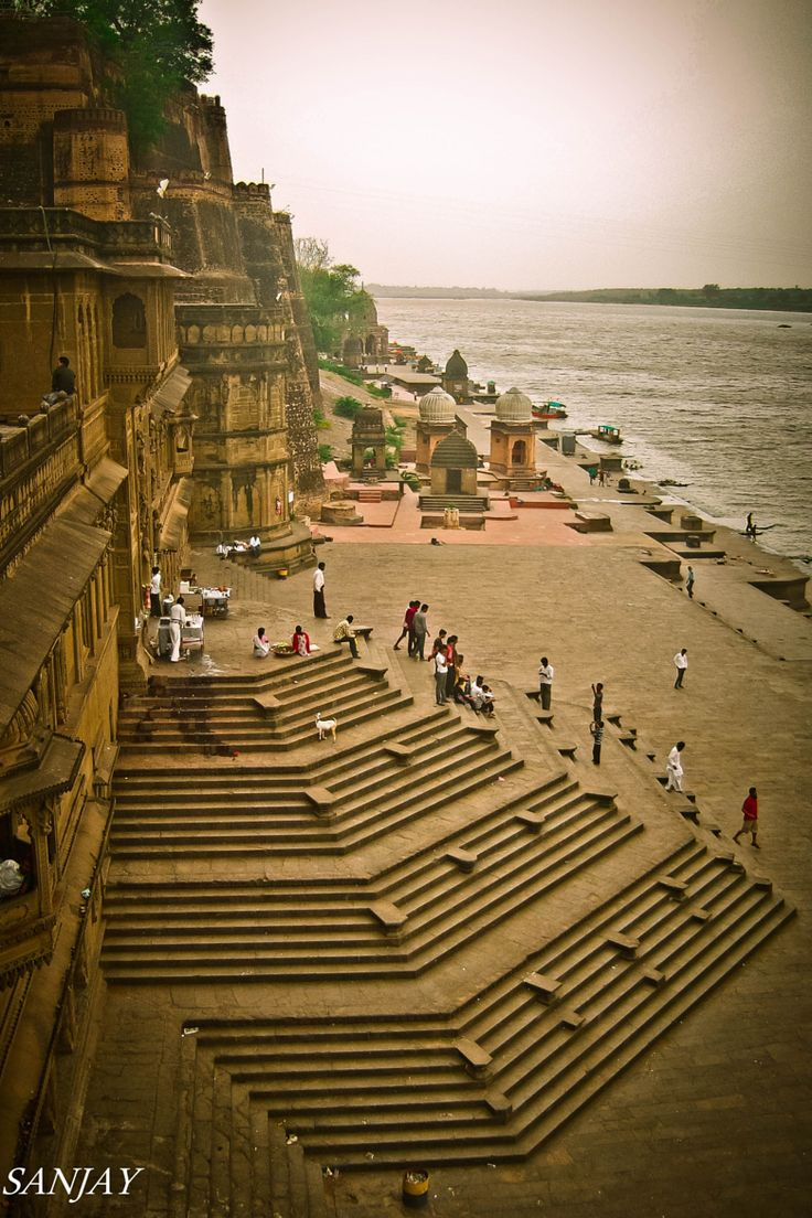 Ahilya fort, Maheshwar city, Madhya Pradesh, India. The City lies on the north bank of the Narmada River. In the late eighteenth century, Maheshwar served as the capital of the great Maratha queen Rajmata Ahilya Devi Holkar,Holkar. She embellished the city with many buildings and public works, and it is home to her palace, as well as numerous temples, a fort, and riverfront ghats (broad stone steps which step down to the river).
