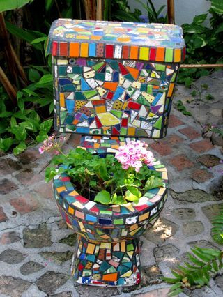 I'm not sure I'd want this planter in my yard ..... no mater how colorful it is.