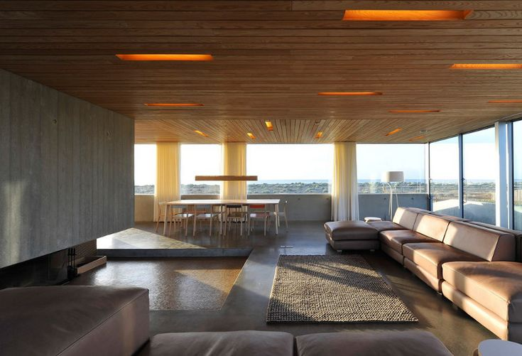 The Dune House.  Fascinating concept, more pics at the link ... main floor has primarily glass walls with 360-degree view of the beach, ocean and, I presume by the name, the dunes.