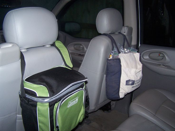 I used a hard sided cooler to hold all my kids electronic gadgets, and a soft sided bag to hold all our trip snacks during our recent 18 hour drive to Disney World. Worked great to maximize space in the back seat of the Trailblazer and kept it neat and tidy and organized.