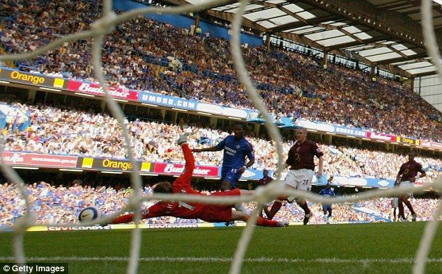 Didier Drogba beats Jens Lehmann to score for Chelsea in victory over Arsenal in 2005