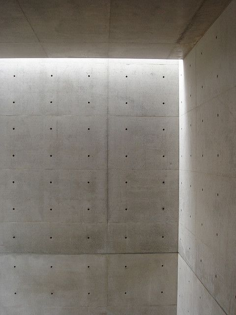 Daylight falling on the bare concrete walls of the Church of the Light by Tadao Ando. Why need any decoration if you can have this? (photo by Naoyafujii)