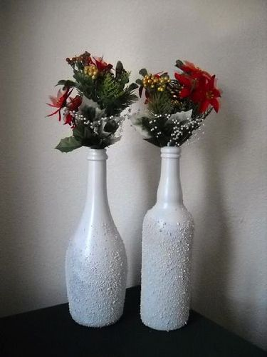 Transform bottles into beautiful vases by spraying adhesive, Epsom salt and white