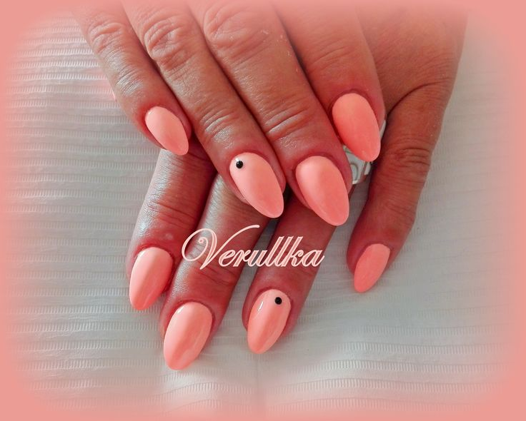 Salmon or peach gel nails with black crystals