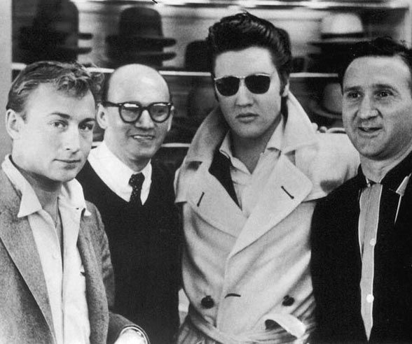 "This photo shows Guy (2nd from l) and Bernard (r) Lansky with Elvis and actor Nick Adams (""Rebel Without a Cause"") at their Lansky Brothers Men's Shop on 126 Beale Street in Memphis, TN in late October 1956."