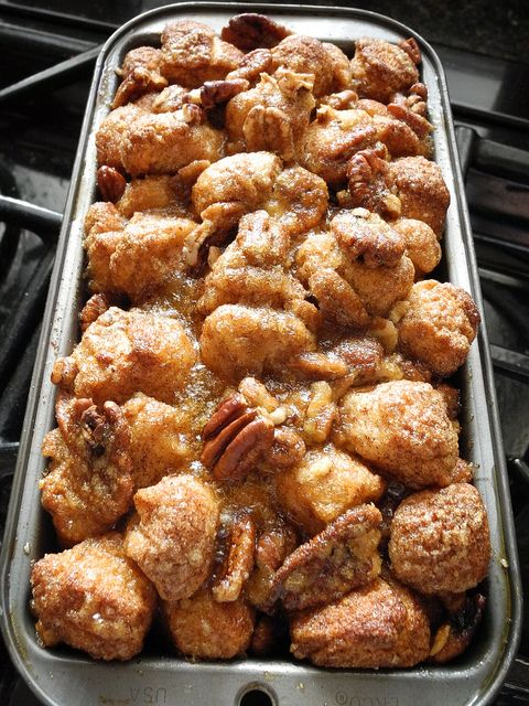 Monkey Bread - 2 cans biscuits, cut into quarters. Shake in a baggie with cinnamon & sugar. Place into bread pan coated with non-stick spray. Melt 1/2 stick butter & 1 cup brown sugar over low heat, stirring so it doesn't burn. Pour over bread & bake for 20-30 minutes. Put half pecan pieces on the bread bites before pouring brown sugar mixture over the top.