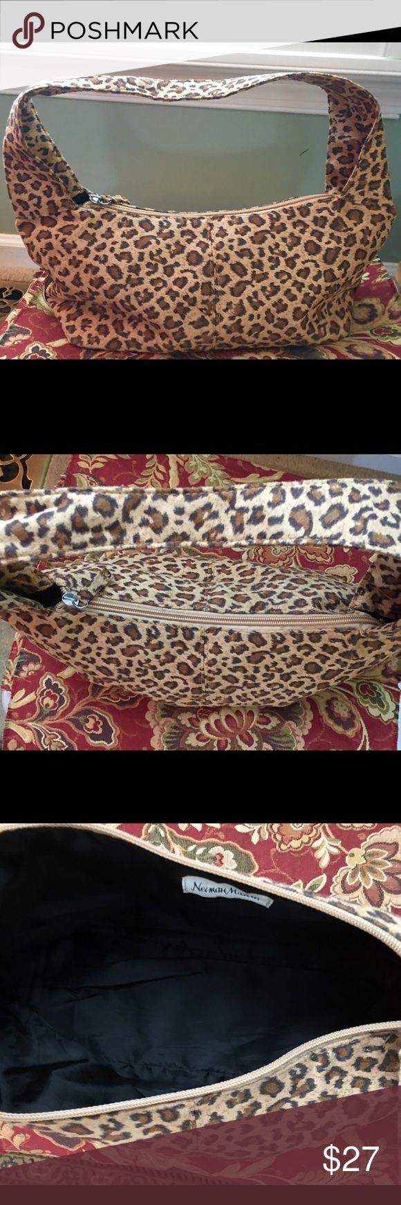Final Sale-Neiman Marcus animal print hobo Neiman Marcus suede-like animal print hobo bag. Used once, too small for me. In great condition. Roughly 9x5x5. Zipper closure. ***FINAL  SALE*** Neiman Marcus Bags Hobos