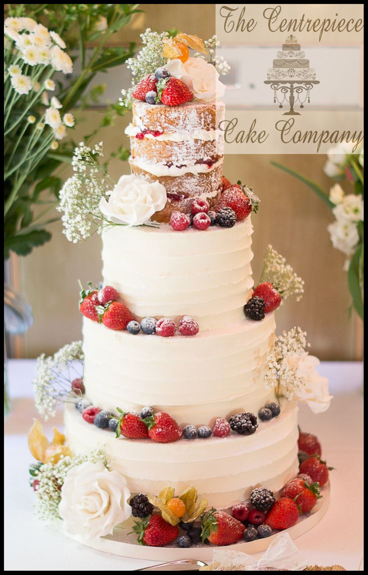 Beautiful rustic bohochic naked wedding cake - with a vintage coating of white chocolate ganache and decorated with fresh fruit and my hand crafted sugar flowers