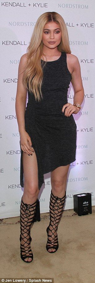 Showing them how it's done:Like her sister, the 18-year-old wore head-to-toe Kendall + Kylie showing off some leg in a simple black dress with a thigh high split on one side and an asymmetrical hemline