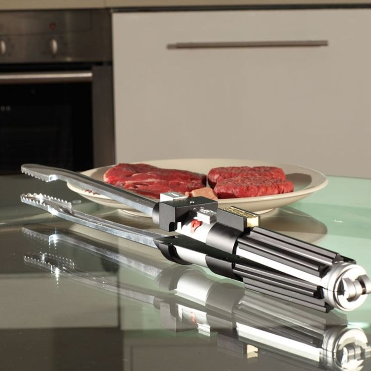 May the grill be with you!   Take BBQ-ing to intergalactic heights with these officially licenced Star Wars Light Saber BBQ Tongs, complete with light saber sound effects (can be turned on and off!)   Shaped just like Darth Vader's famous light saber, you'll rule over the BBQ and the galaxy at your will  The BBQ Tongs feature a protective sheath, heat-proof plastic handle and metal tongs