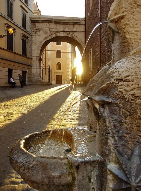 Evening light on a Roman drinking fountain, Rome, Italy.  This Little Fountain in the Via di San Vito is one of a number of fountains designed by the architect P. Lombardi in 1927.