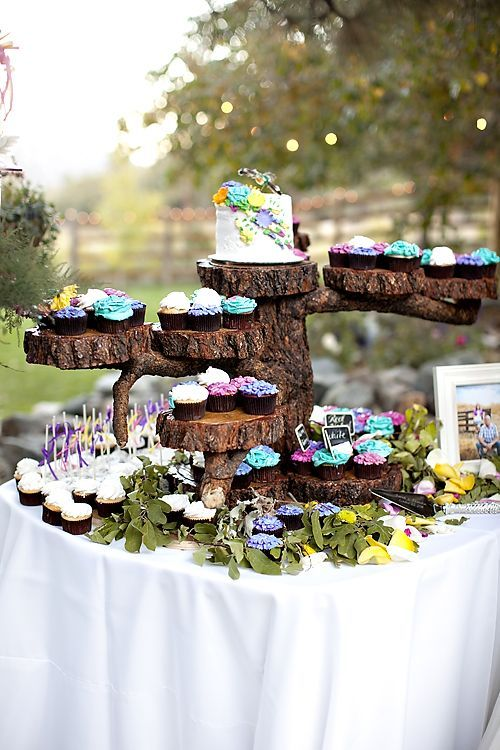 Beautiful cupcakes on a log for an outdoor display....would have to be different colors