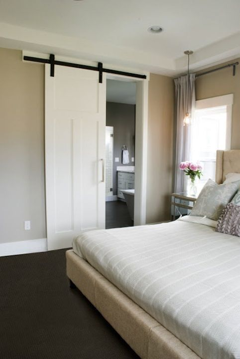 Sliding doors divide without occupying space between a bedroom and bathroom  [ CLICK HERE! ]