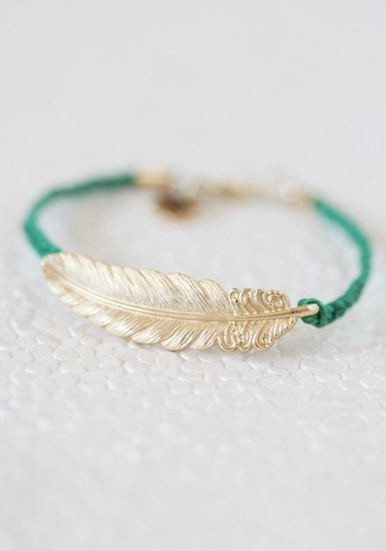 brass feather bracelet with braided aqua cord.