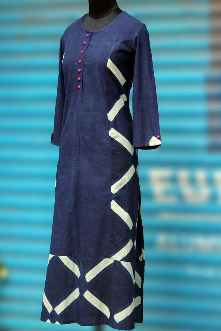 an indigo long kurta with pink potli buttons. the front placket & sleeve fabric is hand-dyed using natural indigo. *mild variations in colour are an integ