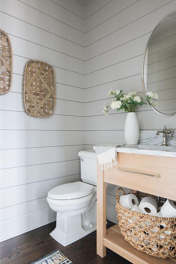 a fresh farmhouse bathroom with off white shiplap,…