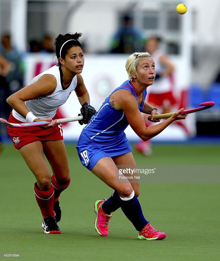 Nicola Lloyd of Scotland is challanged by Sam Quek of England during the Women's preliminaries match between Scotland and England at Glasgow National Hockey Centre during day seven of the Glasgow 2014 Commonwealth Games on July 30, 2014 in Glasgow, United Kingdom.