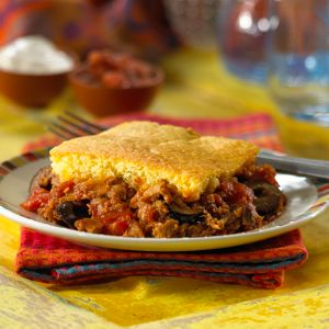 Family favorite—Tamale Pie—makes a great one dish meal. This easy version uses a corn muffin mix, MorningStar Farms® Meal Starters® Grillers® Recipe Crumbles™ and ripe olives.