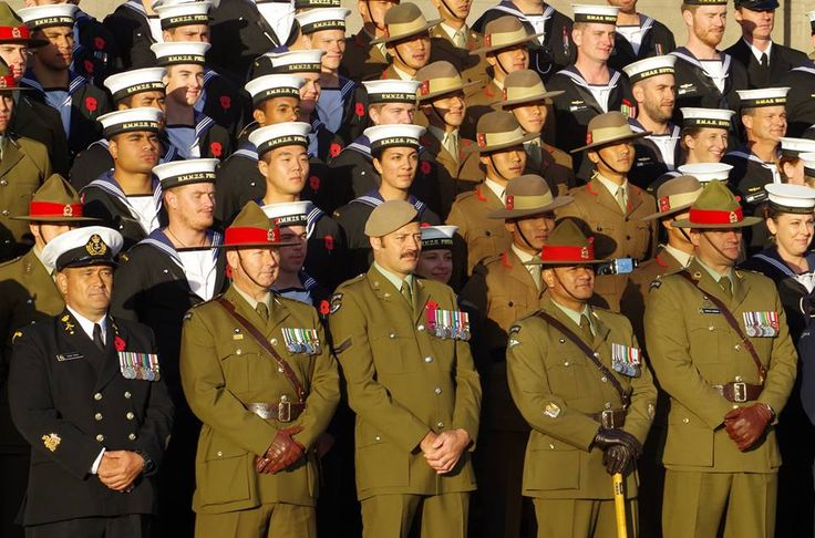 Military personnel from New Zealand, Australia and the Nepal's Gurkhas pose in front of the National War Memorial following the dawn service.