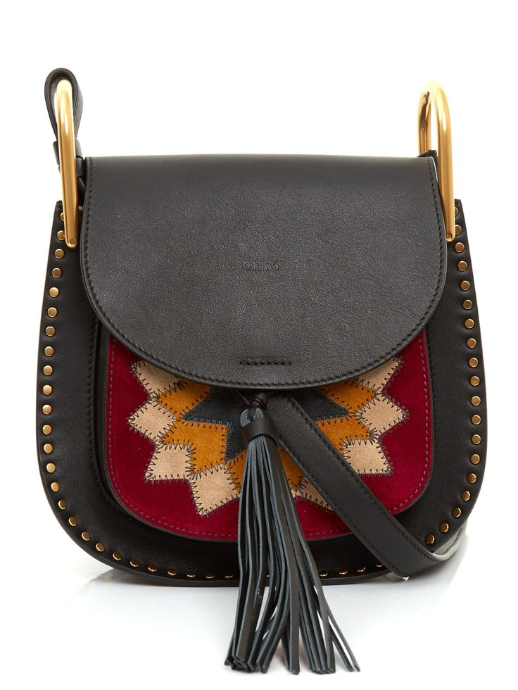 The freshest version of Chloé's black leather Hudson bag is brimming with bohemian spirit. Gold-tone metal studs trim the outside, while a pattern of burgundy, yellow, beige and grey suede decorates the front pocket. Style it over washed blue denim – a mini dress now, and flared jeans come autumn.