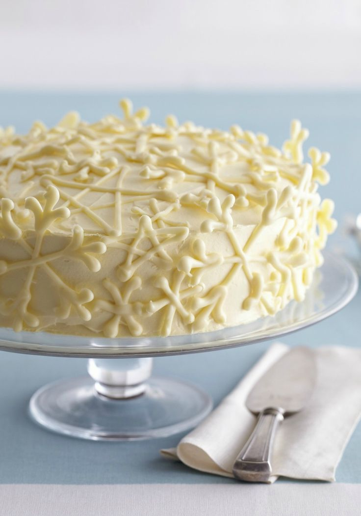 Vanilla Snowflake Cake -- This elegant dessert recipe--perfect for a snow princess party--is more easy than it looks and even more delicious than you'd imagine!