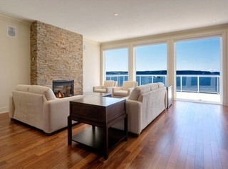 Feng Shui Living Room With A Stone Fireplace