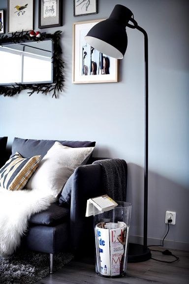 Mirror and picture frames above couch in living room.